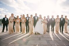 Outdoor Tampa Bridal Party Wedding Portrait | Champagne Gold Sorella Vita Bridesmaid Dresses with White Sweetheart Hayley Paige Wedding Gown and Black Tuxedos