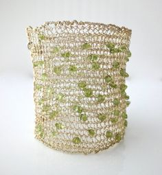 Knitted wire cuff bracelet, with champagne gold wire and green Peridot beads, $125.00