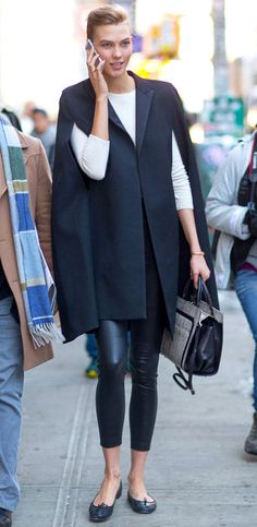 Trending Fashion Style at #FW2014 #FashionWeeks: Karlie Kloss in black cape coat street style during Fall Winter 2014 NYFW.