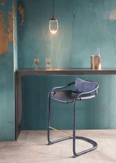 Caribou stool by Ochre  Leather wrapped frame with leather sling seat and brass footbar