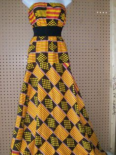 Long strapless kente maxi dress by tambocollection on Etsy ~Latest African Fashion, African Prints, African fashion styles, African clothing, Nigerian style, Ghanaian fashion, African women dresses, African Bags, African shoes, Nigerian fashion, Ankara, Kitenge, Aso okè, Kenté, brocade. ~DK