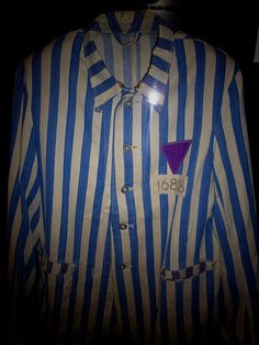 The purple triangle was a concentration camp badge used by the Nazis to identify Bibelforscher (the German name for Jehovah's Witnesses) in Nazi Germany. A small number of Adventists, Baptists, Bible Student splinter groups, and pacifists (combined less than one percent) were also identified by the badge.