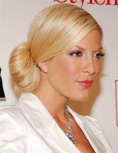 Tori Spelling's sleek bun hairstyle