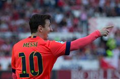 Lionel Messi of FC Barcelona celebrates scoring their opening goal during the La Liga match between Sevilla FC and FC Barcelona at Estadio Ramon Sanchez Pizjuan on April 11, 2015 in Seville, Spain.