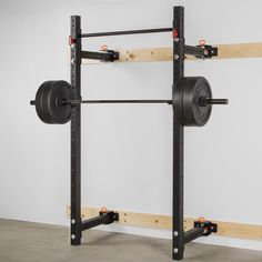 """The Rogue RML-3W Fold Back Wall Mount Rack features 3x3"""" 11-gauge steel uprights, Westside hole spacing, and a unique hinge and pin system. Get yours today at Rogue!"""