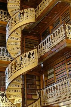 Grand Spiral Staircase Design -this is a library I Love it!