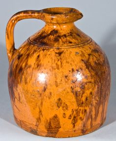 """Anthony Weis Bacher (1824–1889) - Syrup Jug. Glazed & Manganese Decorated Redware, Incised on Bottom with """"A. W. Bacher"""". Winchester, Virginia. Circa 1880."""