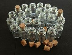*25 Mini Glass Bottles with Cork Lids. Starting at $5 on Tophatter.com!