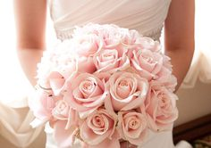 bouquet except with red roses and a silver ribbon around the stems