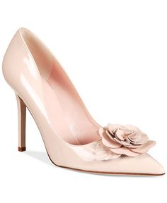 kate spade new york's Linden pumps have a cute flower embellishment that makes them the perfect finishing touch for a flirty dress. | Leather upper; leather sole | Imported | Pointed closed-toe pumps