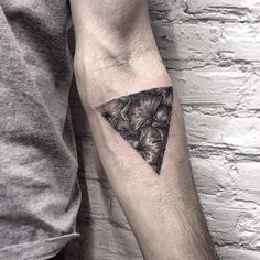 A truly well detailed Triangle Glyph Tattoo design. Created in black and gray the design gives you depth on whether to focus looking at it as a bunch of flowers or even veins trapped in a triangle shape. It's beautifully designed and cleverly detailed.