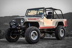Drawing inspiration from the graphic laden CJ-8s of the 1980s, this Legacy Jeep Scrambler is a hand-built homage to that iconic truck. It's powered by an all-aluminum 6.2L V8 engine making 430 hp, more than enough to propel its 3,300...  Gimme that! Please?