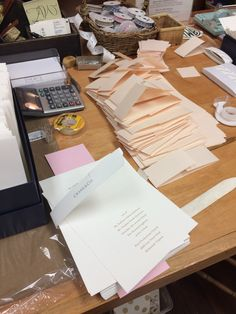 Assembling the bands onto invitations featuring blind embossing and raised ink.