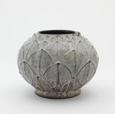 Shiwan ware vase in lotus bud form (neck cut down)  Medium: Stoneware with opaque white glaze Style: Shiwan (Shekwan) ware Type: Ceramic, Vessel Origin: Shiwan (Shekwan) kilns, Foshan, Guangdong province, China Topic: flower, Ming dynasty (1368 - 1644), lotus, China, Shiwan ware, stoneware