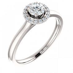 Un model incantator de inel de logodna din aur alb, incrustat cu diamante.