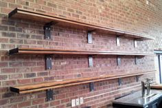 MagnerVision Bar Shelving: Industrial steel brackets with reclaimed pine flooring for Gonza y Tequila in Wake Forest, NC.