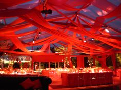 Red draping for a Rio Carnival themed corporate event or private party. For more information on how we could recreate a picture like this contact www.stressfreehire.com or email info@stressfreehire.com