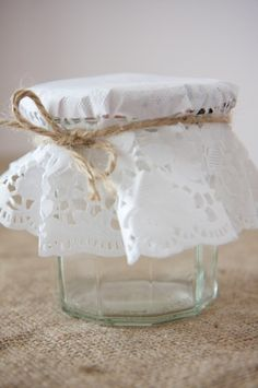 paper doily jam jar decorations - would be pretty to put a battery powered tea light in side