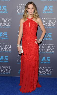 Lady in red! Emily Blunt radiated in this Emilio Pucci lace gown and Lorraine Schwartz jewels.