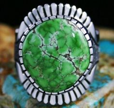 Alton Bedonie Carico Lake Spiderweb Turquoise Ring #AltonBedonie  Dazzling lime green Carico Lake turquoise is the finest and most sought after from this classic mine. The highest grade is seldom encountered. This exceptional natural specimen has marvelous tan spiderweb matrix as well. It sits in a high hand chiseled bezel with radiating fans at each end. The shank is finely cut to shape and textured prior to oxidation. The finished ring is a marvelous collectible, one of Alton's most…