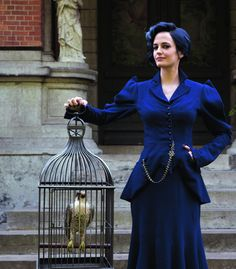 In this view of Miss Peregrine (Eva Green) you can appreciate just how blue (not black) her jacket and skirt really are. Nice detailing on the jacket, the pockets and the pocket watch.  You also get to see her and her peregrine peculiar. From the September issue of Post Magazine in September issue. Photo by ©Leah Gallo. From Ovivolp