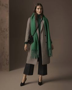 Limited Edition coat, £89, M&S Collection polo neck, £17.50, M&S Collection trousers, £39.50, scarf, £17.50, bag, £29.50, shoes, £35.