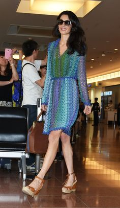 Amal Clooney arriving at Tokyo's airport. See all of her best looks.