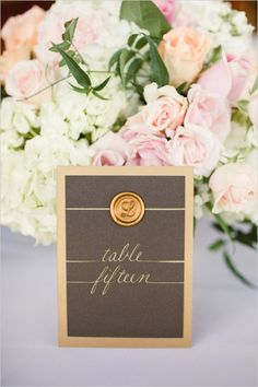 gold table numbers at wedding reception #tablenumbers #weddingreception #weddingchicks http://www.weddingchicks.com/2014/02/07/pink-and-black-wedding/