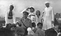 Governor general Lord Mountbatten salutes India's National flag alongside his wife, Edwina, and prime minister Jawaharlal Nehru during India's first Independence Day celebrations in New Delhi, 1947.