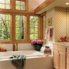 Traditional wood trimmed bathroom with natural lighting Photo by James Yochum