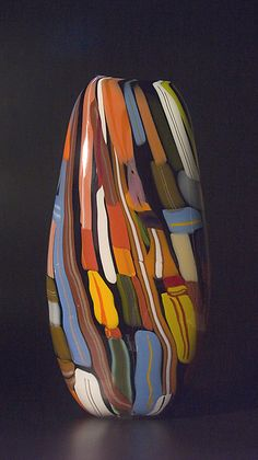 """""""Black Valise"""" by Bengt Hokanson and Trefny Dix opaque glass vessel inspired by sticker covered suitcase."""