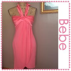 EUC Bebe Halter Dress in Ultrapink, Size Small EUC rayon halter dress with silk contrast bust line and halter straps by Bebe. Size Small but could fit up to a size 8. Color-Ultrapink. Rare; no longer sold by Bebe. No rips, tears, or stains. bebe Dresses Asymmetrical