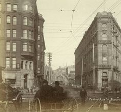 James St. and Yesler Way from Pioneer Square, ca. 1898 :: Seattle Photographs Shows Pioneer Building on left, Occidental Hotel in center .