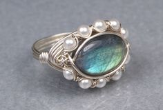 Labradorite Sterling Silver Ring - Oval Gemstone and White Swarovski Pearls Wire Wrap Ring - Size 4, 5, 6, 7, 8, 9, 10, 11, 12, 13, 14. $40.00, via Etsy.