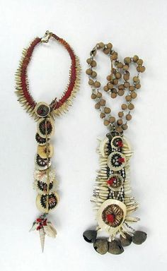 Solomon Islands | Necklaces/Chest ornaments; shell, dog teeth, boar tusk, seeds, and coconut discs