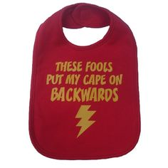These fools put my cape on backwards baby bib infant toddler boy / girl / unisex funny superhero shower gift -  red and yellow. $12.00, via Etsy.
