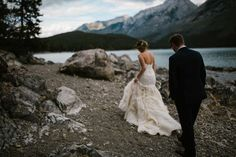 I met Katie and Justin the moment I walked into their suites at the Rimrock Resort Hotel in Banff on their wedding day. Little did I know, just how amazing these two would be! Julie at Rocky Mountain Weddings brought this Fort McMurray couple's vision to life in the Rocky Mountains. With family that came in from England, Quebec and Northern Alberta – it was a true destination dream day. (Lake Minnewanka Wedding Banff Photographer)  I loved how their two young sons were so much a part of the…