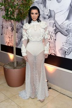 Kim Kardashian West looked angelic in a white Givenchy gown at the Daily Front Row's Annual Fashion Los Angeles Awards in West Hollywood.