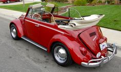 Maleko Mistr Mahalo's Rubi Red 1966 Beetle Cabriolet. Member of HerrKooled Inland Empire, located in Temecula, Southern California. With the original 1300 Engine in the garage, a 1600 engine was installed to keep up with traffic on the highways. This beauty is looking for a matching Rubi Red Bus to complete her relationship…