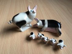 Adorable Miniature Hagen Renaker Mama and Papa Pigs with Piglets Family, total of 7 figurines by CrazyWhiskers on Etsy https://www.etsy.com/listing/294961479/adorable-miniature-hagen-renaker-mama