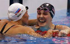 Russia's Anastasia Zueva congratulates U.S. Missy Franklin's win and world record in the women's 200m backstroke final