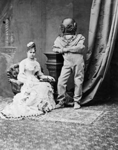 Edwardian couple - one in a diving suit. Perfectly incongruous. I love the fact that his pose is exactly as if he wasn't wearing the diving suit.