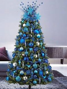 Try this Trend : Layered Blues For a cool and classic look, layer your tree in a full range of blues from the deepest sapphire to a soft powdery hue. a True, Blue Christmas Blue Christmas Tree Decorations, Peacock Christmas Tree, Beautiful Christmas Trees, Elegant Christmas, Noel Christmas, Xmas Tree, Christmas Wreaths, Turquoise Christmas, Christmas Canvas