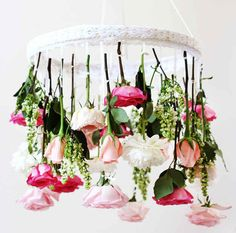 Deck out your wedding in flowers from the floor all the way to the ceiling with a flower chandelier DIY. Flower Chandelier, Diy Chandelier, Hanging Flowers, Diy Flowers, Fresh Flowers, Diy Hanging, Flower Diy, Hanging Lanterns, Orange Flowers