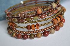 Fall colors jasper memory wire bracelet. Southwestern memory wire bracelet.  Gorgeous earth tone Red Creek Jasper gemstones paired with antique copper and complimentary seed beads on memory wire. This particular bracelet wraps around your wrist 7 times and has the looks of 7 unique bracelets. The oval shape of this particular memory has a more natural fit for your wrist.  listing of beads: Red Creek Jasper Tierra Cast antique copper beads and bead caps Toho seed beads: