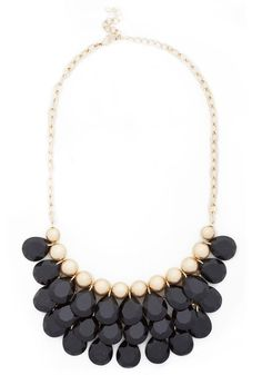Dazzling Dame Necklace in Black. Wow the world with your formidable and feminine style with this cascading statement necklace! #black #modcloth