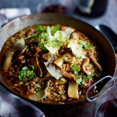 Barley Risotto with Garlicky Mushrooms | Chef Naomi Pomeroy uses barley to make her hearty version of risotto, packed with sautéed oyster mushrooms.