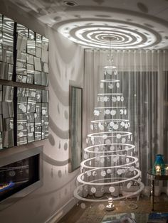 """Memory"" Christmas tree - modern tree with battery-powered rotating disco ball and floor lamp which casts beautiful shadows on walls and ceilings."