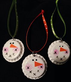 "Recycle those bottle caps, spray them white and make these adorable snowman ornaments! Use a q-tip to gently paint a hint of pink for the cheeks. Easy little painted ""x's"" make the mouth. Turn your paintbrush over and use the end to create the eyes. A dab of orange becomes a nose. Seal the image with a spritz of glitter spray. Add some skinny ribbon and you're ready to hang this adorable guy!"