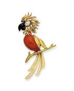 A CORAL, ENAMEL, DIAMOND AND GOLD PARROT CLIP BROOCH